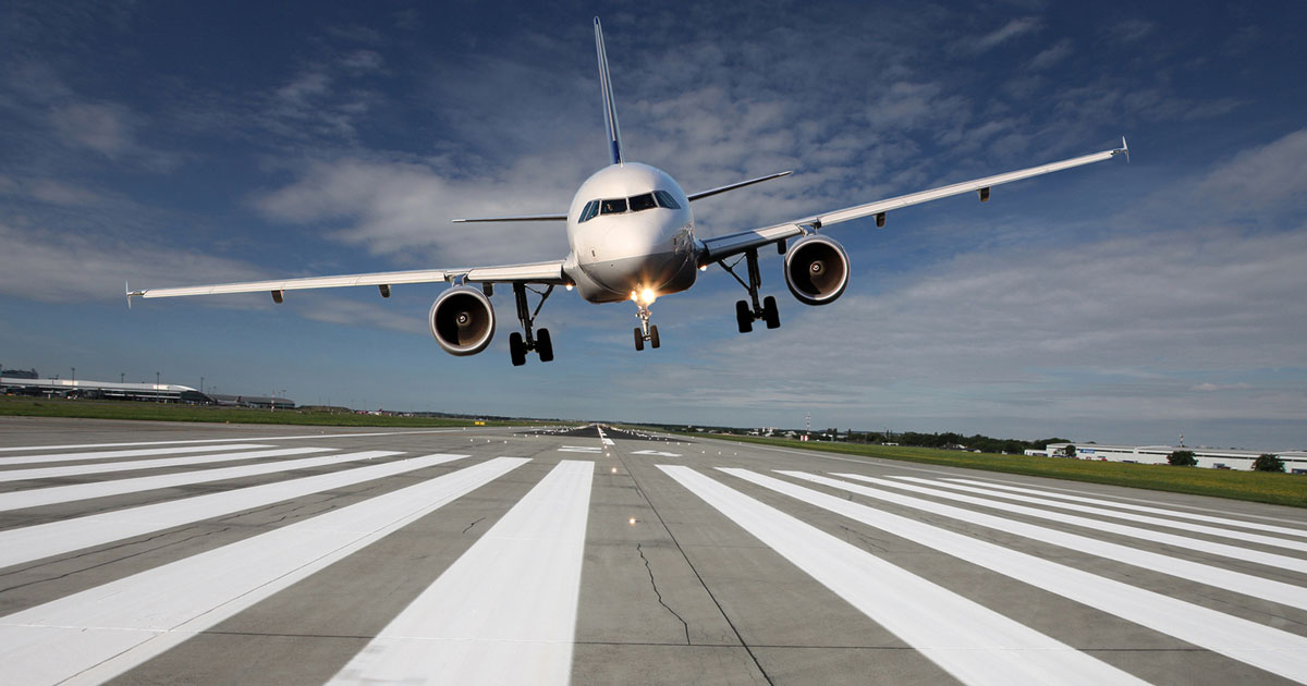bigstock-Aircraft-Low-Over-The-Runway-79267360